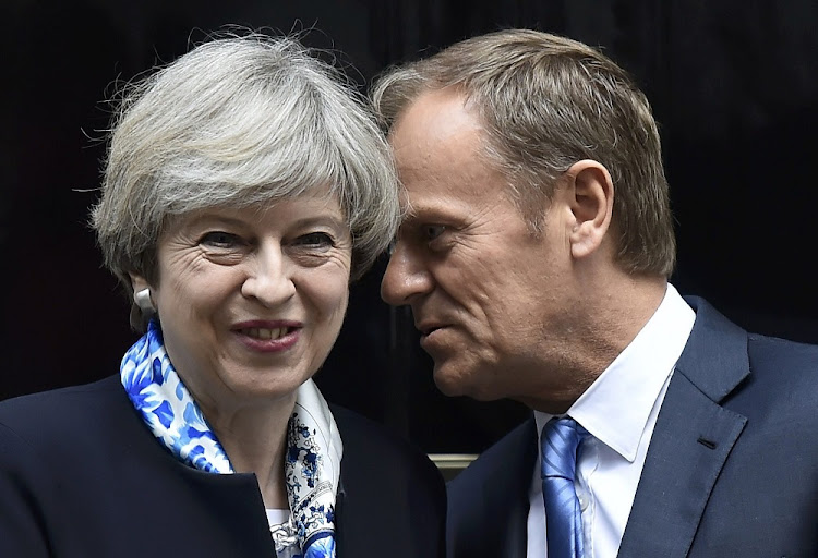 British Prime Minister Theresa May greets European Council president Donald Tusk outside 10 Downing Street, in central London. Picture: REUTERS/HANNAH McKAY