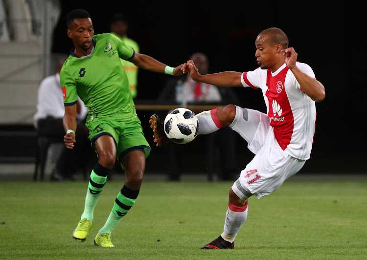 Fagrie Lakay of Ajax Cape Town challenged by Molemo Mekoa of Platinum Stars during the Absa Premiership 2017/18 football match between Ajax Cape Town and Platinum Stars at Cape Town Stadium, Cape Town on 12 January 2018.
