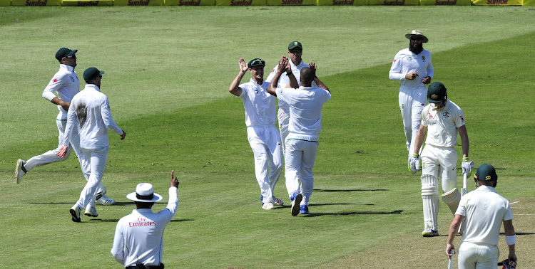 Vernon Philander of South Africa gets congratulated for his wicket during day 1 of the first test between South Africa and Australia at Kingsmead Cricket Ground in Durban on 1 March 2018.