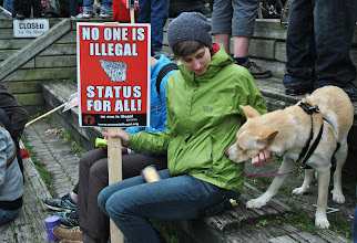 Photo: A woman takes a seat next to her dog.
