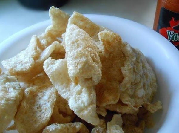 Place Chicharones in food processor and bring them to a finely crushed state. ...