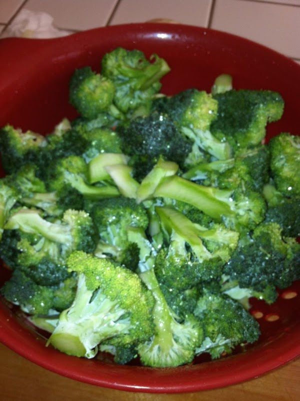 Then add your chicken stock, broccoli, carrots and onions.  Simmer until the broccoli...