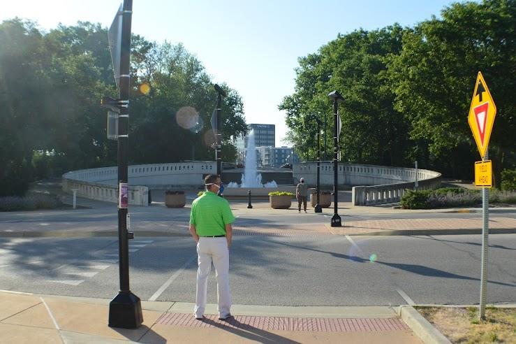 Picture: Pedestrians utilize a solar-powered crosswalk.