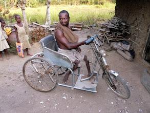 Photo: à Athiémé, nous retrouvons Laurent Adjara sur le tricycle donné par le CTM en 1994 !