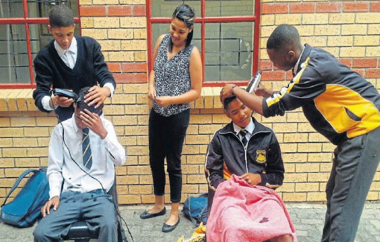 Cutting edge: Pupils who have attended the Columba programme are inspired to be proactive, including starting a barber club. Picture: SUPPLIED