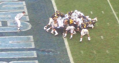 Photo: Matthews' own Ryan Houston tries to go over the top of the pile.