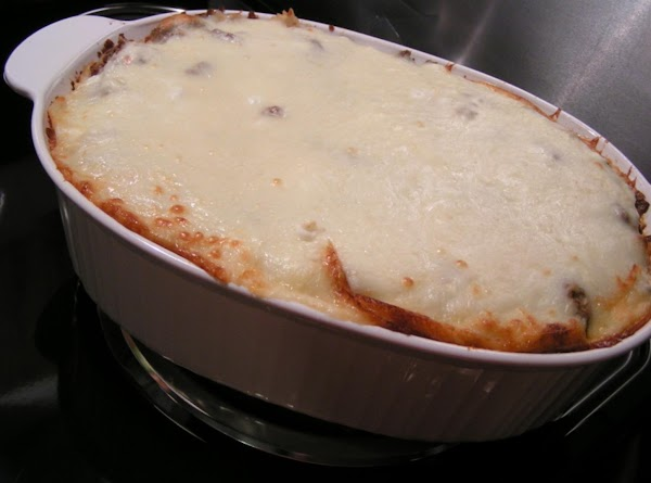 Remove cover; continue baking until Mozzarella Cheese melts and browns slightly.