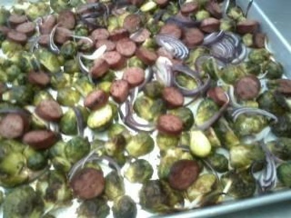 Preheat oven to 450.Toss sprouts, onion and kielbasa in bowl w/ oil, salt, &...