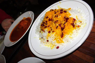 Photo: At the Persian restaurant Ayeeda on Church Street, Bangalore this March. Near side is Biryani rice with Persian cheese (may be goat cheese) and rum buds topping, and back side is tomato based chicken stew (both are very sweet). I am used to Indian spicy foods, so I badly needed some red chilli in these exotic dishes! 3rd August updated -http://jp.asksiddhi.in/daily_detail.php?id=259#.UfyIbMwkZG8.twitter