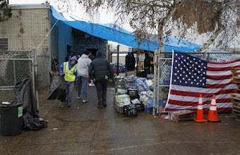 Photo: People gather outside a makeshift community outreach center in Staten Island, N.Y., Nov. 7. The center was hastily set up by a group of friends wanting to help their neighbors following Hurricane Sandy. (CNS photo/Bob Roller) (Nov. 8, 2012) See SANDY-STATENISLAND Nov. 8, 2012.