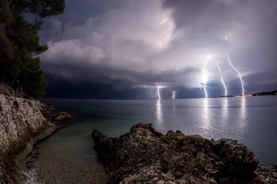 Amazing night by Matic Cankar - Landscapes Weather ( thunder, clouds, lightning, village, autumn, beautiful, sea, night, storm, rocks, coast,  )