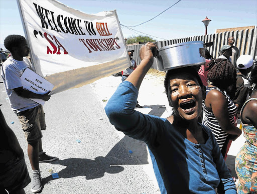 EQUAL TREATMENT: The Social Justice Coalition and residents march in Khayelitsha to demand that Sinoxolo Mafevuka's killing be given the same attention as that of Franziksa Blöchliger