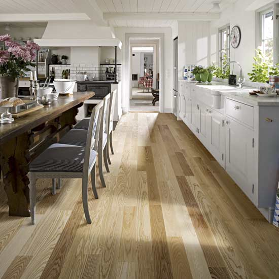 Floor color: Gray tones mixed with light creams and tans suggest a floor  worn over time, evoking a classic yet contemporary style.