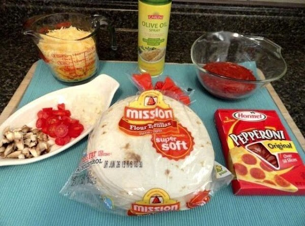 Flour tortillas, pizza sauce- spread pizza sauce on tortillas and place on pan.( you...