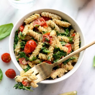 Vegan Cheezy Pasta with Basil, Kale, and Tomatoes