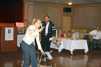 Photo: Mariah, Mariah Sound Occassions, holds mad cow back from dance floor.  Dave Bold, Done-Rite Plumbing, watches table six.