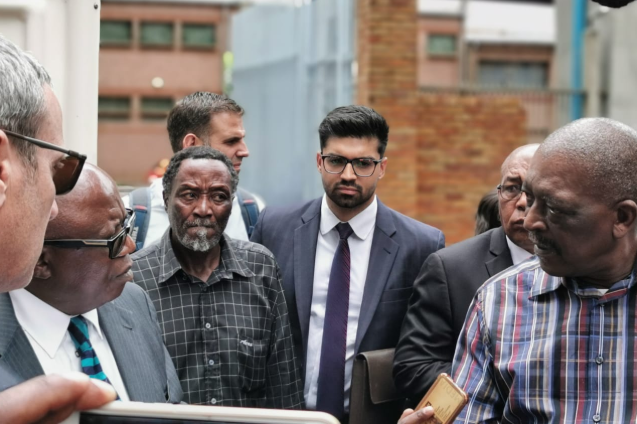 Mahanoe Makhetha, third left, watches as his former colleague, Joe Nyampule, addresses judge Motsamai Makume at an inspection in loco at Johannesburg central police station.