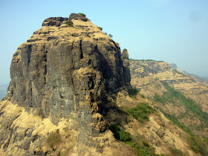 Photo: Great view of Mahuli Fort from high up on Bhatoba.  A flag marks the fort and several hikers thought our communication was us trying to get their attention.  It was several minutes of shouting back and forth before they got the idea that we weren't talking to them!