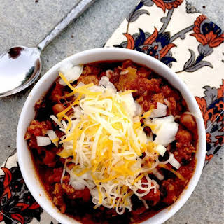 Easy Weeknight Chili with Black Beans, Pinto Beans, and Sweet Italian Sausage.