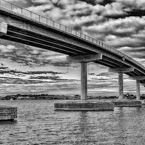 Hindmarsh Island Bridge by Susan Marshall - Black & White Buildings & Architecture ( clouds, water, hindmarsh island, bridge, landscape, river,  )