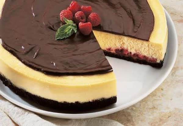 Delicious Cheesecake With A Piece Missing.