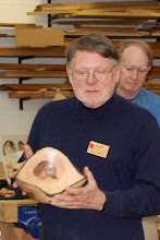 Photo: Richard Webster talks about his freshly-turned, natural-edge dogwood bowl.