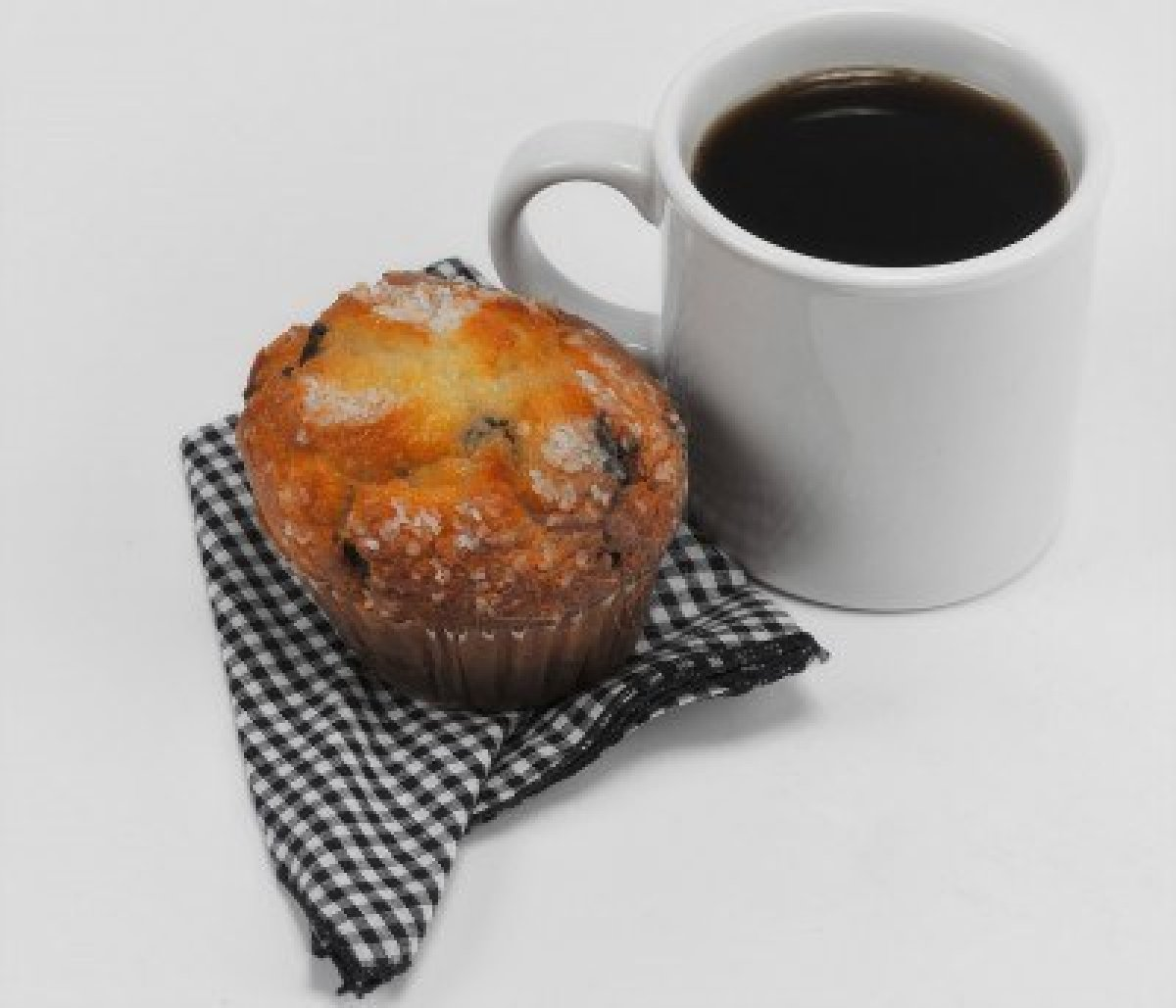 5596792-coffee-and-muffin-on-isolated-white-background.jpg