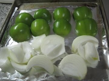 Cut the onion in pieces and place on the sheet pan also. Turn oven to...