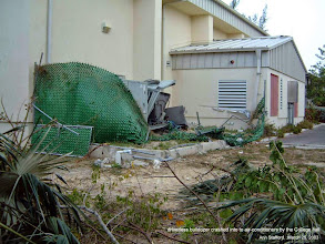 Photo: 2003 March: Runaway driverless bulldozer crashed into air-conditioning units by the Community College of the Cayman Islands hall, after the driver was attacked by bees and jumped off the bulldozer. There was a very loud explosion sound when the bulldozer hit and finally came to a stop. Photo: Ann Stafford, Mar. 25, 2003.