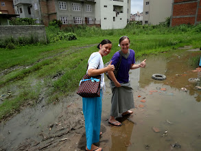 Photo: This was on our way to Pastor Tulshi's house. These brave sisters crossed this mud hole as if it was main street normal city side walk.
