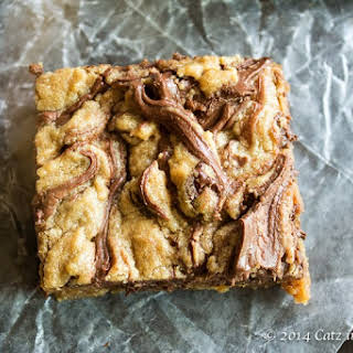 Peanut Butter and Chocolate Chip Nutella Swirled Blondies.