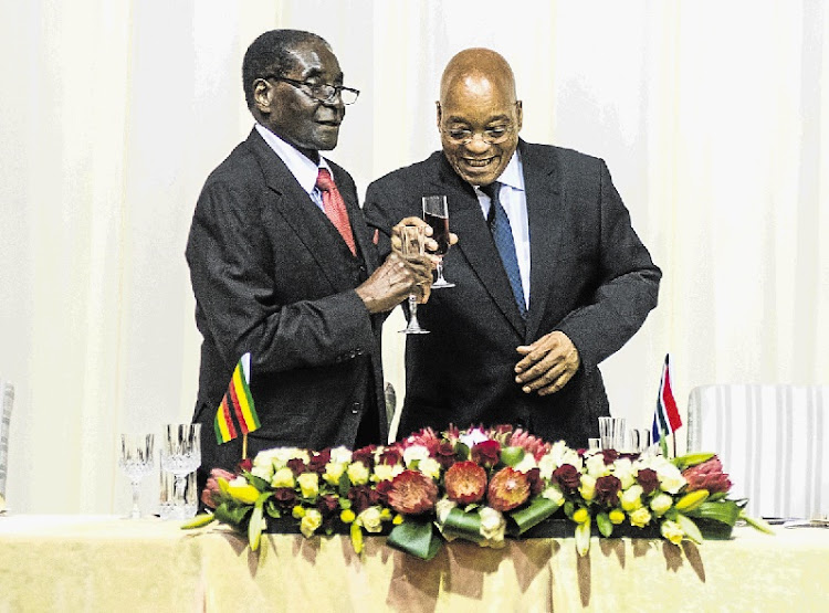 IMMUNITY IDYLLS: Former Zimbabwean president Robert Mugabe, left, and South African President Jacob Zuma. File picture: SUNDAY TIMES