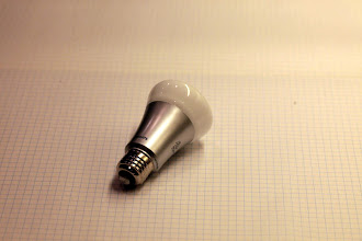Photo: Bulb is a glass top with plastic-covered aluminum base
