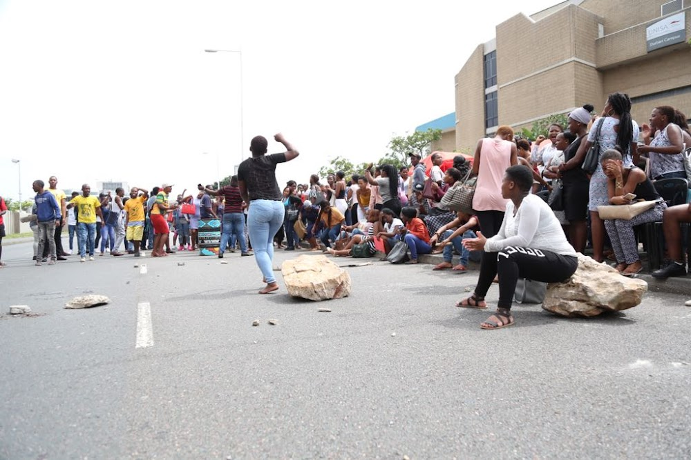 WATCH | Police fire stun grenades at protesting Unisa students in Durban - TimesLIVE