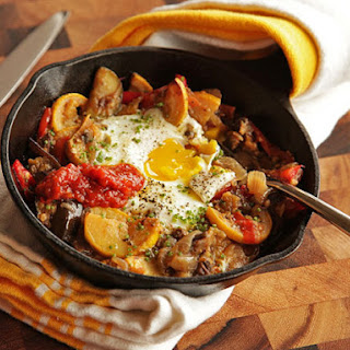 Eggplant, Squash, and Cherry Tomato Hash With Baked Eggs.