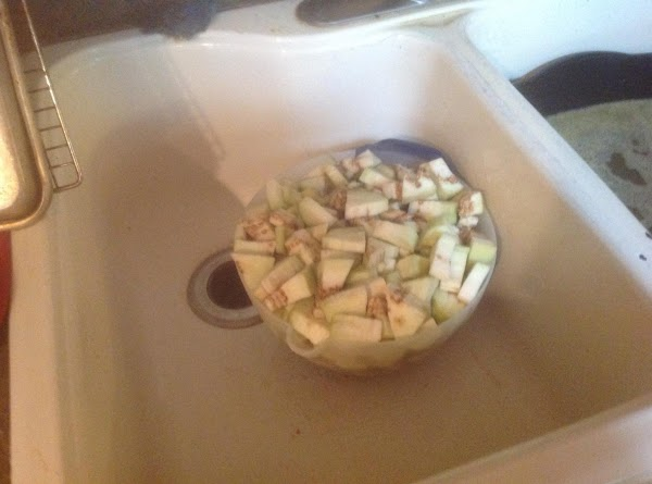 Add eggplant to large bowl and cover with water, and allow to sit at...