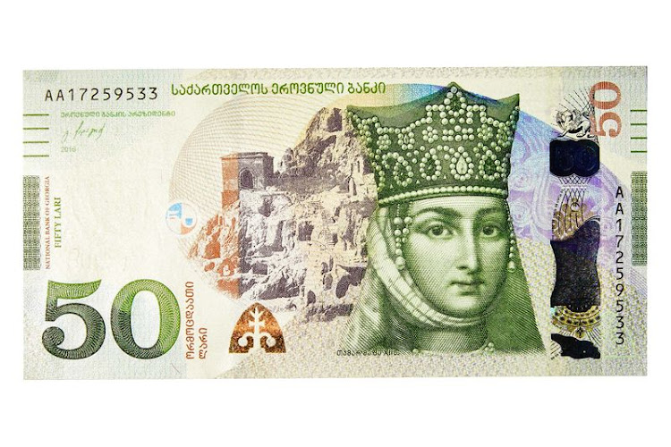 "50 lari On the front is Queen Tamar, who ruled the country from 1184 to 1213, a period known as the ""Georgian Golden Age."" The note has a holographic stripe and a magenta-to-green security thread."