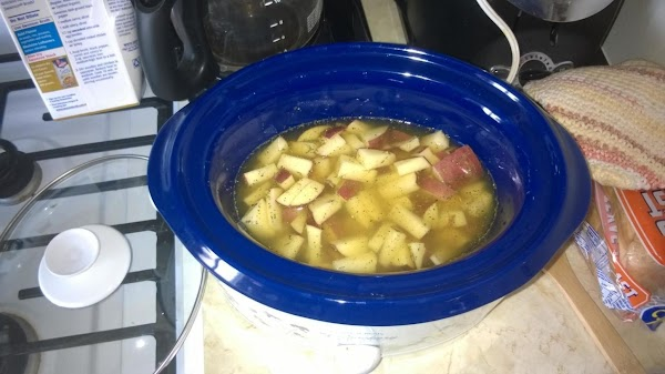 Add your spuds, onions and broth to your crock pot and cook on high...