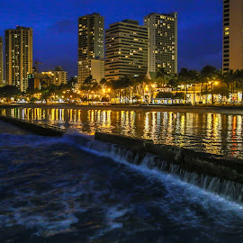 Honolulu Walls by Kathy Suttles - City,  Street & Park  Night ( waves, hawaii, night refletions, cityscape, honolulu walls, suttlimpressions )
