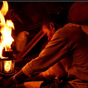Lighting of Fire by Vinay Ad - People Portraits of Men