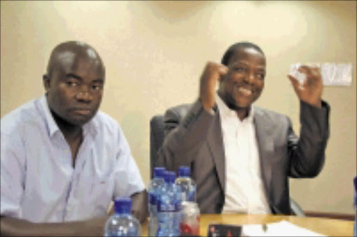 OUT: Bohani Shibambu with board chairperson Sello Rasethaba during yesterday's media briefing. Pic: Chester Makana. 10/11/2009. © Sowetan.