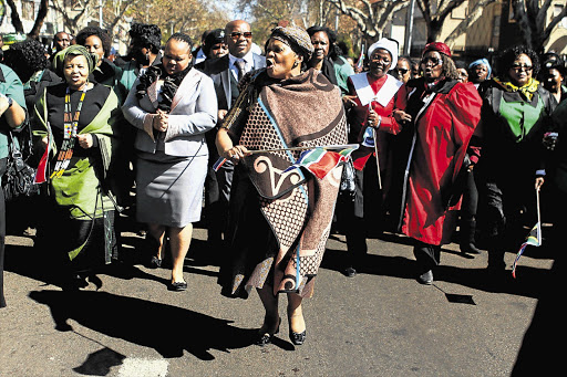 Premier of Gauteng Nomvula Mokonyane, first lady Nompumelelo Ntuli and Minister for Women, Children and People with Disabilities Lulu Xingwana lead a march from Lillian Ngoyi Square to the Union Buildings in Pretoria yesterday in commemoration of the 1956 women's march against pass laws