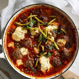 Baked Lebanese lamb meatballs with peas and labna.