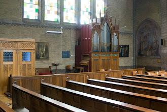 Photo: Het orgel voor in de kerk stamt uit 1900 en is gebouwd door Maarschalk in Weert. Het is enige jaren geleden in de Petrus en Pauluskerk geplaatst.  Aan de linkerzijde van het orgel ziet u de ingang naar de Mariakapel, dit is tevens de deur naar onze invalide ingang waar rolstoelgebruikers gebruik van kunnen maken.  The organ in front of the church was build in 1900 by organ builderMaarschalkfrom the city of Weert.  On the left side of the organ you can see the entrance to our Saint Mary's chapel, this is also the entry for people with disabilities. By creating this special entrance our church is wheelchair accessible.