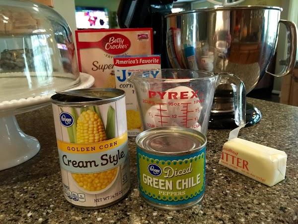 Mix yellow cake per box instructions.Mix jiffy per box instructions.Combine