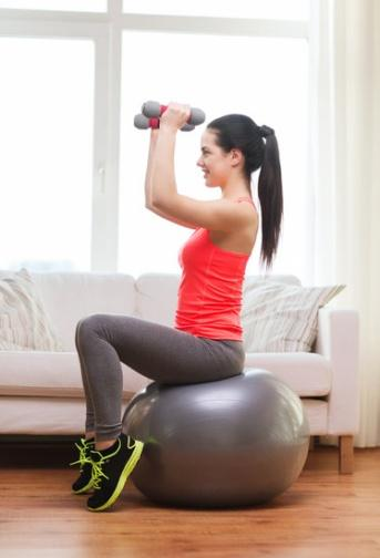 canva-smiling-girl-exercising-with-fitness-ball-MAA8BSnFOHc.jpg