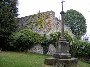 Photo: The trail leads quickly to, of course, to la Croix St Côme, a memorial from 1874. The walls behind conceal the château d'En Haut (the Upper Castle).