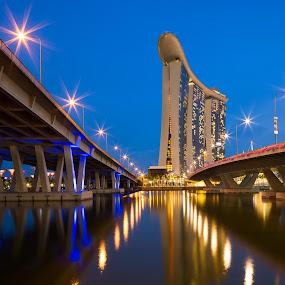 Twin Bridges to Marina Bay Sands by Richard Amar - City,  Street & Park  Skylines ( marina bay sands, reflections, canon eos 5d mark iii, star burst, singapore, marina bay, canon ts-e24mm f/3.5l ii, canon gps receiver gp-e2, leading lines, vanishing point, starbursts, casino, long exposure, hotel, bridge, twilght, pwcskylines )