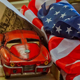 Free To Be by Barbara Brock - Artistic Objects Still Life ( red, toys, red toy corvette, toy muscle car, american symbol, red toy car, redwhiteblue, american flag )