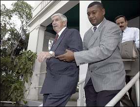 Photo: Cuban exile Luis Posada Carriles, left, is helped out of the Maritime Tribunal in Panama City, Panama Monday, March 15, 2004. A trial began today for Carriles and three other Cuban exiles, Gaspar Jimenez Escobedo, Guillermo Novo Sampol and Pedro Remon Rodriguez who are being charged with of conspiracy, possessing explosives and endangering the public's safety. They have been detained in Panama since November 2000 after Fidel Castro, who came to Panama for the Ibero-American Summit, accused them of attempting to assassinate him. (AP Photo/EFE, Marcos Delgado)